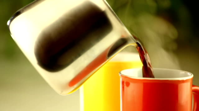 Pouring fresh black coffee video