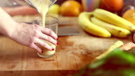 Pouring fruit smoothie into glass video