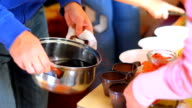 HD Pouring hot mulled wine from pot into the cups video