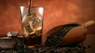 Pouring iced coffee, slow motion video