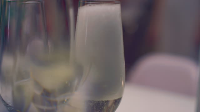 Pouring in sparkling wine video
