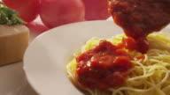 Pouring marinara sauce onto spaghetti video