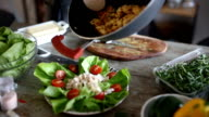Pouring meat over salad video