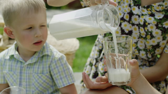 pouring milk in a glass video