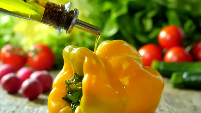 pouring olive oil over a bell pepper video