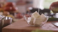 Pouring olive oil over feta cheese video