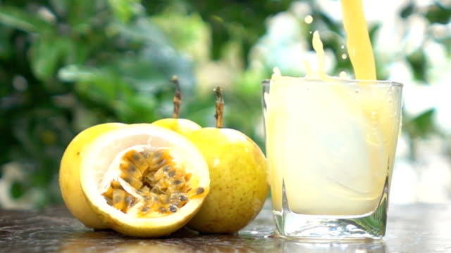 Pouring passion juice in the glass video