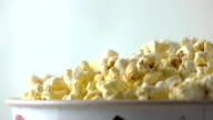 Pouring popcorn into box. Cinema or fast food concepts. Super slow motion dolly shot video