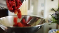 Pouring Raspberries into a Bowl video