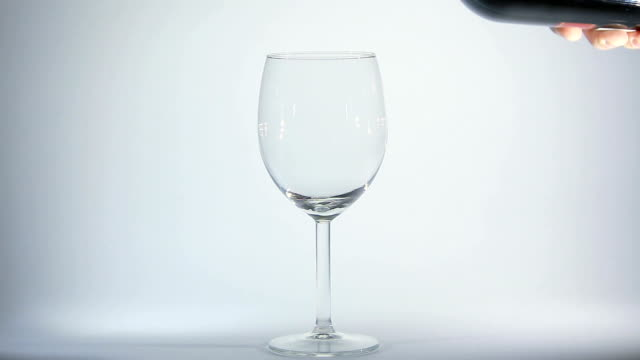 Pouring red wine into a glass. video