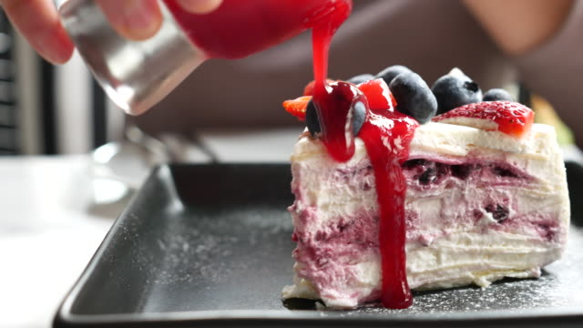 Pouring strawberry jam on Blueberry Cheese cake video