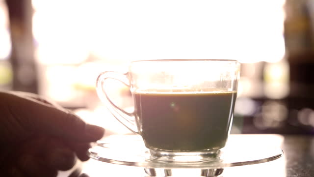 Pouring sugar into a cup of coffee video