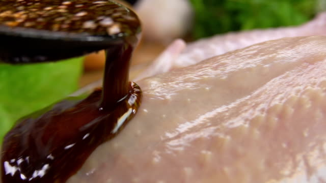pouring the marinade on the chicken video