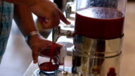 Pouring tomato juice into a glass video