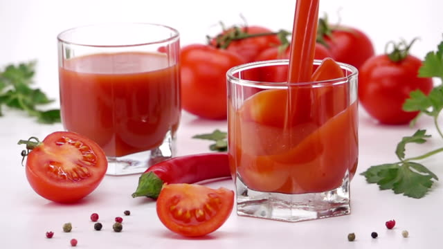 Pouring Tomato Juice Into Glass. video