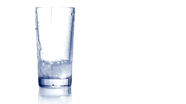 Pouring water in empty glass video