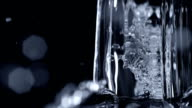 Pouring water on black background, Slow Motion video