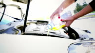Pouring windshield washer fluid. video