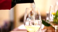 Pouring wine in a glass, slow motion. video