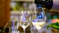 Pouring wine in a restaurant. video