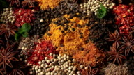Pours black pepper peas. Mixing spices. video