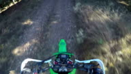 PoV: Enduro racer riding bike on dirt track through the forest video