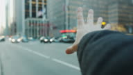 Pov male hand arm hailing cap taxi New York City video