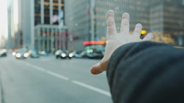 Pov male hand arm hailing cap taxi New York City video