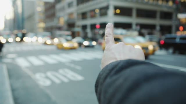 Pov male hand arm hailing cap taxi New York street video