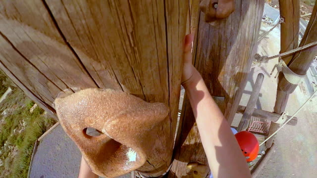 Pov of extreme professional climber climbe on climbing tower video