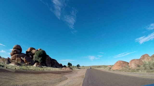 Pov of vehicle driving to the Devil's Marbles video