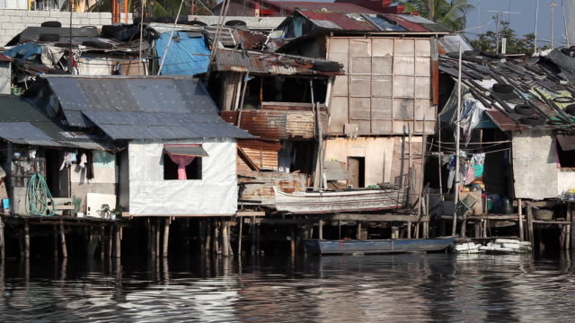 HD poverty housing along river video