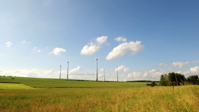power generating wind turbines in the countryside video