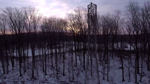 Power line tower sunrise video