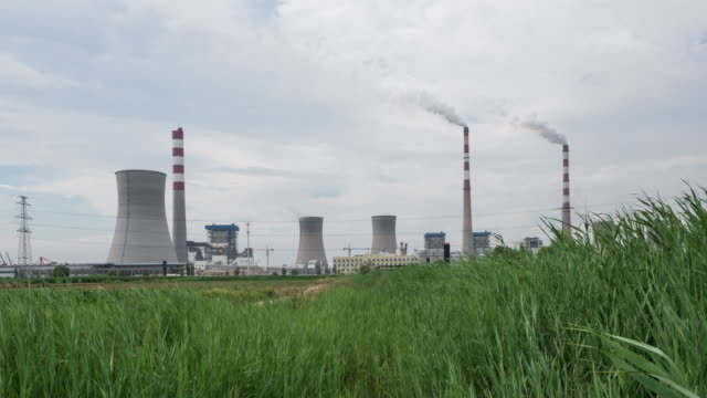 power plant and grassland in Dongying in cloudy sky, timelapse 4k video