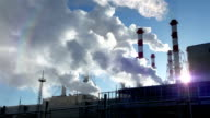 Power plant chimneys against bright sun video