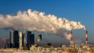 power plant emitting smoke and vapor in cold weather video