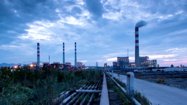 Power station generating electricity and traffic day to night ,time lapse. video