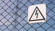 Power substation. Warning sign about the risk of electric shock. High-voltage wires on the support, production and transportation of electricity. life threatening. dangerous video