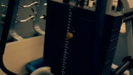 Power training apparatus with different weights in a fitness club video
