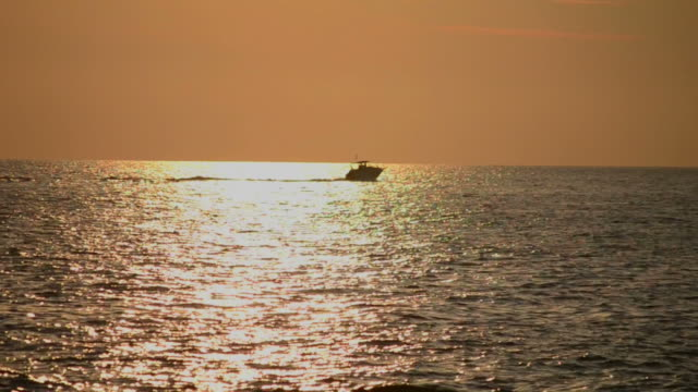 Powerboat at sunset video