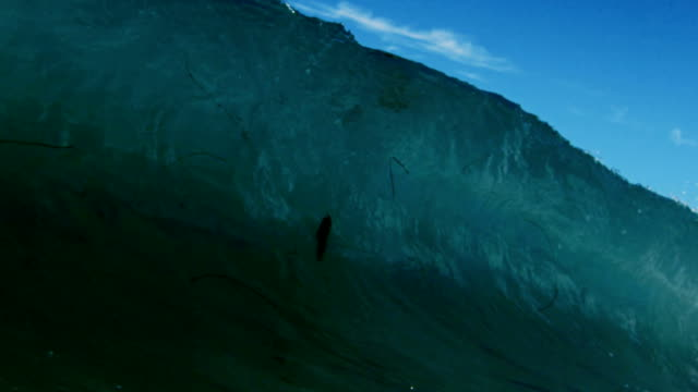 Powerful clean wave POV as wave breaks over camera on shallow sand beach in the California summer sun. Shot in slowmo on the Red Dragon at 300FPS. video