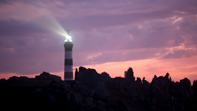 powerful lighthouse in pink sunset video