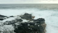 Powerful Ocean Waves Crashing into Lava Rock video
