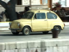 Practical Small Eastern European Car Driving Along Waterfront video