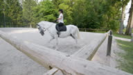 DS Practicing horse riding in the longe with trainer video