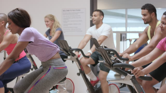 Practicing Indoor Cycling in a Fitness Class video