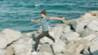 Practicing parkour in the beach rocks video