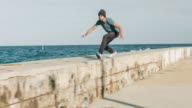 Practicing parkour next to the sea video