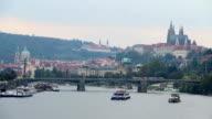 Prague bridge riverside view Castle Petrin mountain Vltava river. Beautiful shot of Europe, culture and landscapes. Traveling sightseeing, tourist views landmarks of Czech Republic. World travel, west European trip cityscape, outdoor shot video